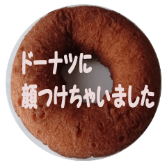 Sticker with face on donut