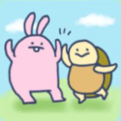 野原で戯れるウサギとカメ