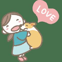 Little girl and corgi
